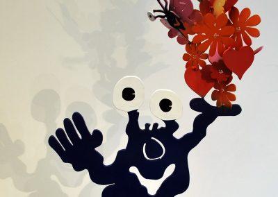 Monster mit Blumen und Schmetterlingen